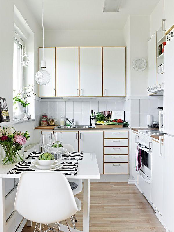 Small White Kitchen with Dining Set
