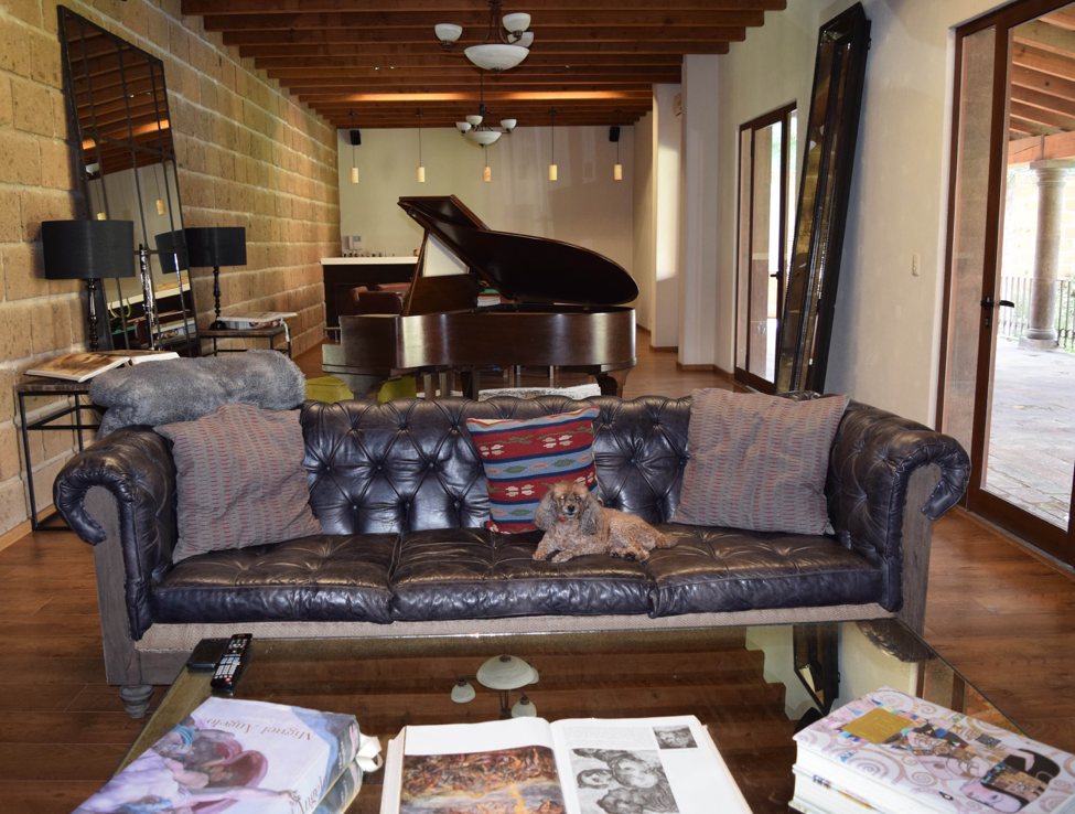 Moving to a New City with K. Tyson Perez - San Miguel de Allende apartment - dark elements - living room with piano